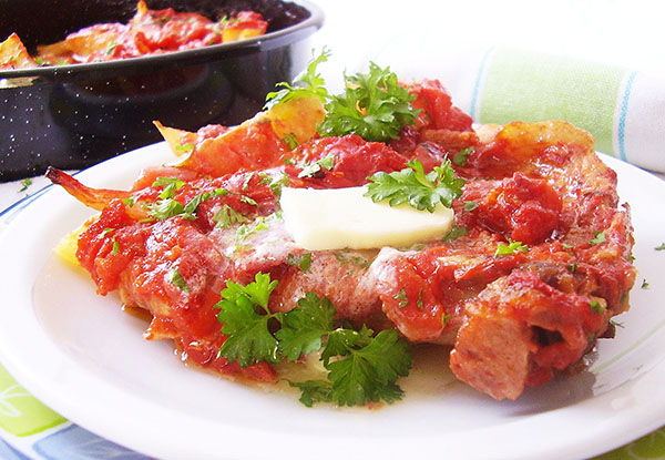 Greek Style Potato Wedges with Pork Chops: tender meat and potato wedges, bathed in tomato sauce.
