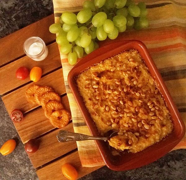 Mediterranean Hummus Bake Recipe : nutty and spicy spread bake to serve with crackers, yogurt and grapes.