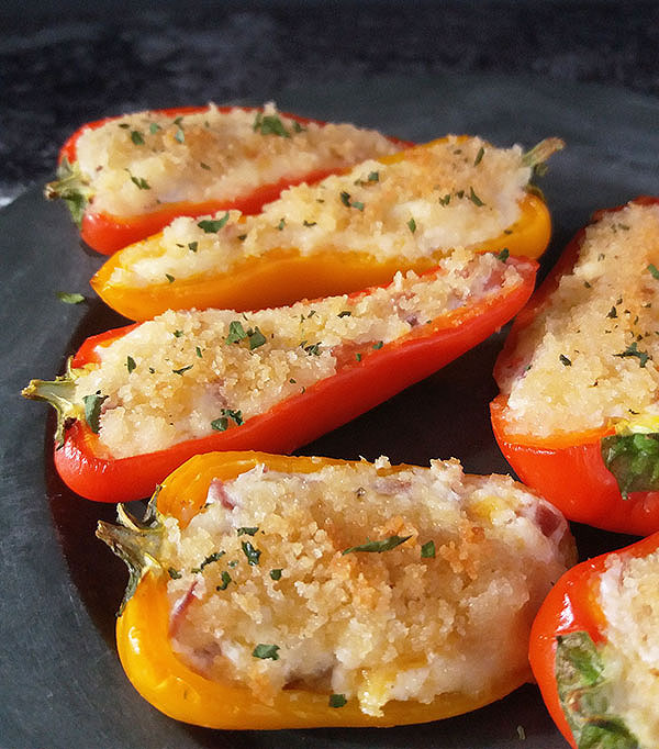 Baby Bell Pepper Poppers: Irresistible baked multicoloured mini bell peppers filled with tasty ingredients, covered with golden brown bread crumbs.