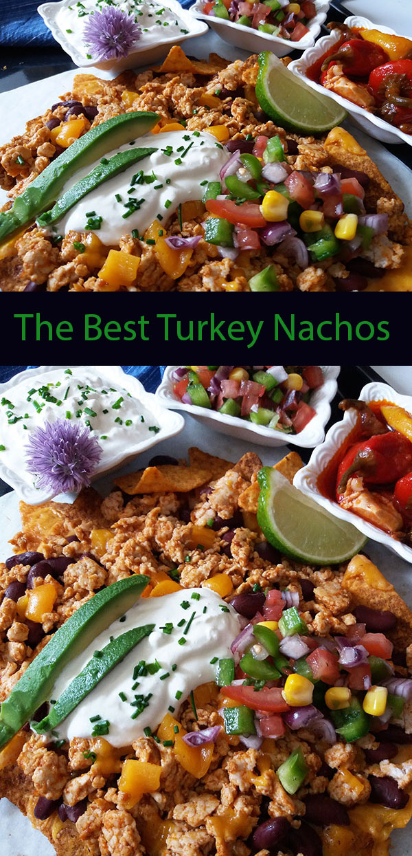 The Best Turkey Nachos : sheet pan nachos, loaded with red beans, minced turkey meat, Cheddar, garnished with pico de gallo , avocado and sour cream.